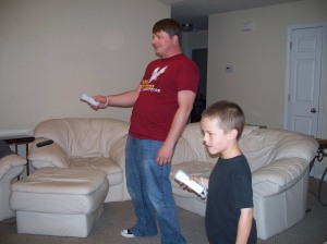 Kevin & CJ playing Wii-gonna miss that family when they move to Texas